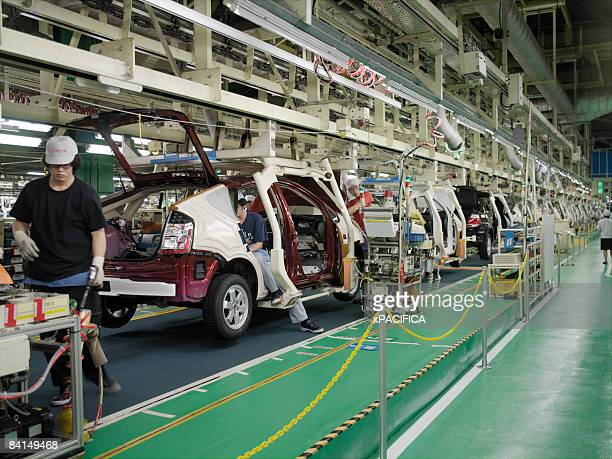 the assembly line at the toyota prius factory. - toyota motor co stock pictures, royalty-free photos & images
