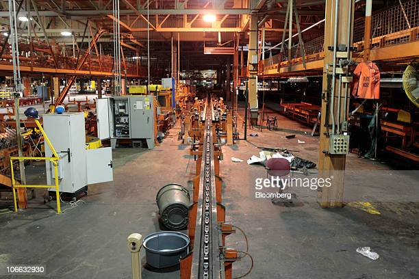 The assembly line during a liquidation auction sits idle at the permanently shutdown General Motors Co Pontiac Assembly plant in Pontiac Michigan US...