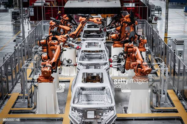 The assembly line of NIO ES8 electric vehicle is seen at a plant jointly built by Chinese automaker Anhui Jianghuai Automobile Group Corp., Ltd. And...