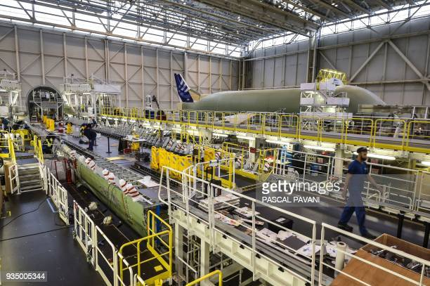 The assembly line of the Airbus Beluga XL large transport aircraft is pictured on March 20 2018 in Blagnac near Toulouse southwestern France The...