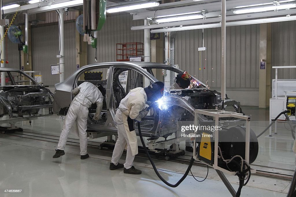 The assembly line of the Honda Amaze car is pictured inside the company's manufacturing plant at Tapukara on February 24, 2014 in Alwar, India. The Rs 3,520-crore plant, which has a total production capacity of 1.2 lakh cars per annum, effectively doubles the companys total manufacturing capacity to 2.4 lakh cars per annum.