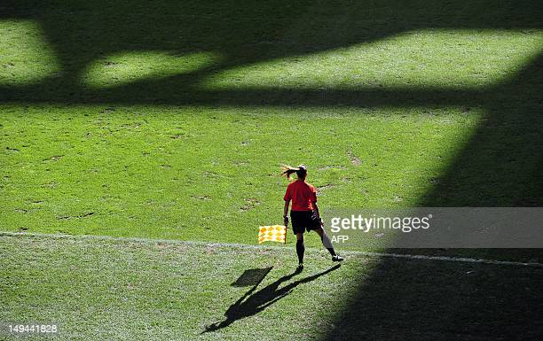 The assistant referee is pictured during the women's football match Britain against Cameroon at the Millennium Stadium in Cardiff Wales on July 28...