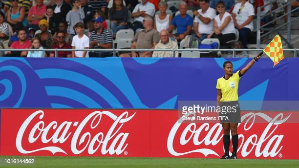 The Assistant Referee Queency Victoire signals during the FIFA U20 Women's World Cup France 2018 group D match between Germany and Haiti at Stade de...