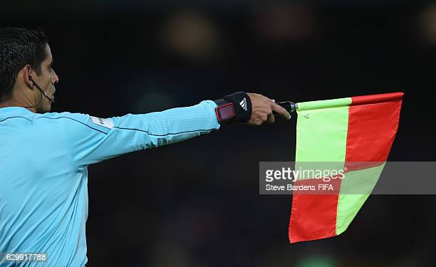 The assistant Referee signal an offside during the FIFA Club World Cup Semi Final match between Club America and Real Madrid at International Stadium...