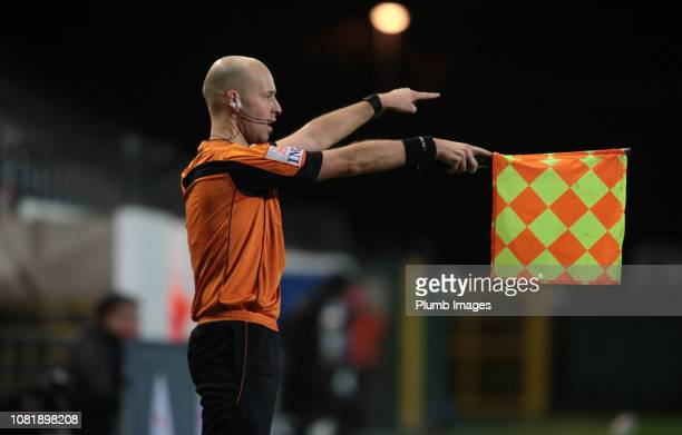 The assistant referee signals for offside during the Proximus League match between OH Leuven and AFC Tubize at King Power at Den Dreef Stadion on...