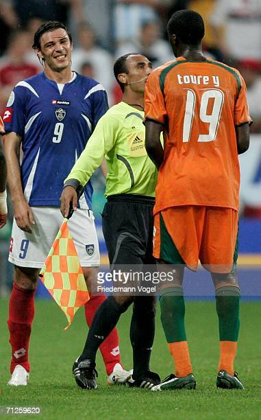 The assistant referee steps in between Savo Milosevic of Sebia Montenegro and Yaya Toure of Ivory Coast during the FIFA World Cup Germany 2006 match...