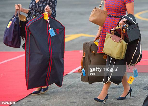 The Assistant to the Duchess of Cambridge's Private Secretary Sophie Agnew and the Duchess of Cambridge's PA and Stylist Natasha Archer carry items...