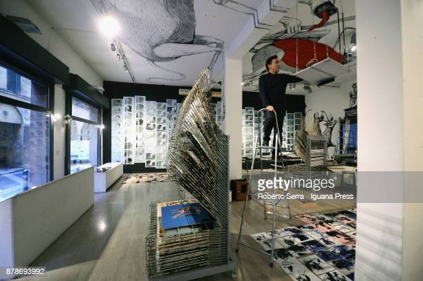 The assistants of the italian Graphic Novelist and artist Stefano Ricci works on the set up of his exhibition 'Segnosonico' during Bil Bol Bul...