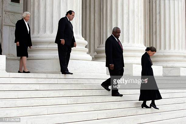 WASHINGTON DC The Associate Justices of the Supreme Court from left Sandra Day O'Connor Antonin Scalia Clarence Thomas and Ruth Bader Ginsburg walk...