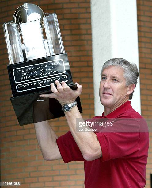 The Associated Press 2003 College Football National Championship trophy is presented to head coach Pete Carroll of the University of Southern...