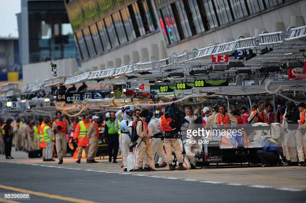The Aston Martin Racing Lola of Stuart Hall Harold Primat and Peter Kox receives pit lane service during practice for the 77th running of the Le Mans...