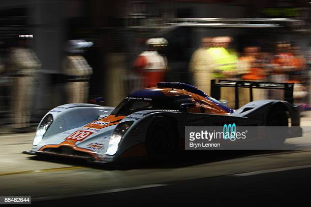 The Aston Martin Racing Lola of Stuart Hall Harold Primat and Peter Kox comes in for a pitstop during the 77th running of the Le Mans 24 Hour race at...
