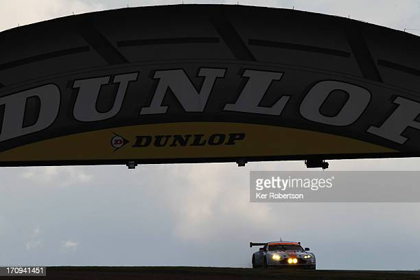 The Aston Martin Racing Vantage of Jamie Campell-Walter, Roald Goethe and Stuart Hall drives under the Dunlop Bridge during qualifying for the Le...