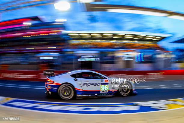 The Aston Martin Vantage V8 of Roald Goethe, Stuart Hall, and Francesco Castellacci drives on pit road during qualifying for the 24 Hours of Le Mans...