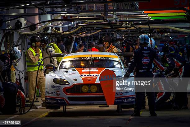 The Aston Martin Vantage V8 of Roald Goethe, Stuart Hall, and Francesco Castellacci makes a pit stop during qualifying for the 24 Hours of Le Mans on...