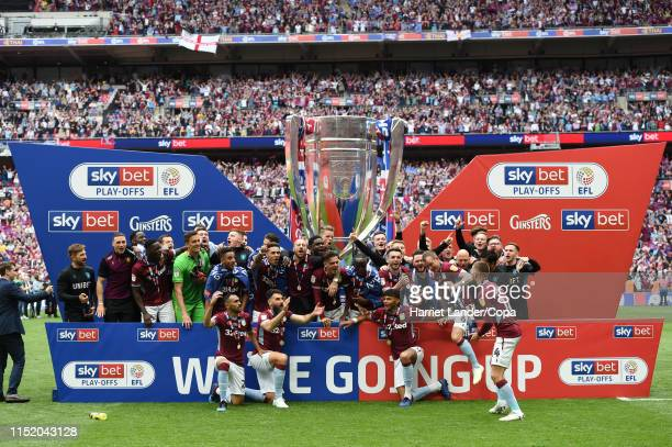 The Aston Villa team celebrate with the Sky Bet Championship Playoff Final Trophy following their team's victory in the Sky Bet Championship Playoff...