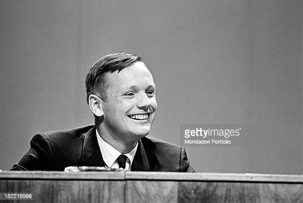 The astronaut Neil Armstrong is smiling during a speech Apollo 11 moon landing program has required Armstrong Aldrin and Collins years of training...