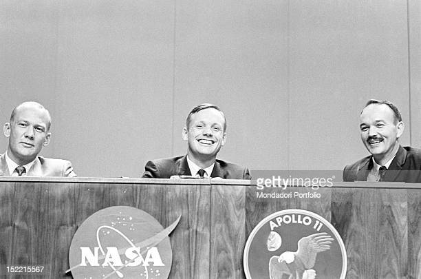 The astronauts Neil Armstrong Michael Collins and Buzz Aldrin during a NASA press conference in a good view the NASA badge and the badge of the...