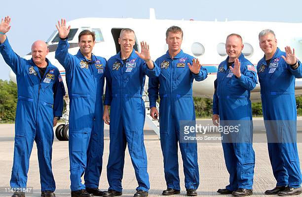 The astronauts of space shuttle Endeavour from left commander Mark Kelly Canadian born US astronaut Greg Chamitoff mission specialist Drew Feustel...