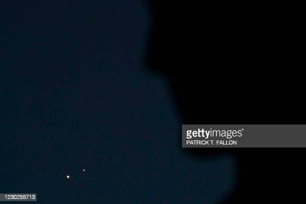 The Astronomers Monument frames planets Jupiter and Saturn during the great conjunction as seen from the Griffith Observatory on the same day as the...