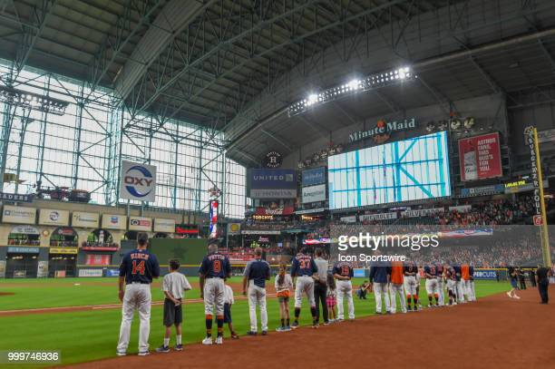 The Astros line up for the National Anthem with some young future players before the baseball game between the Detroit Tigers and the Houston Astros...