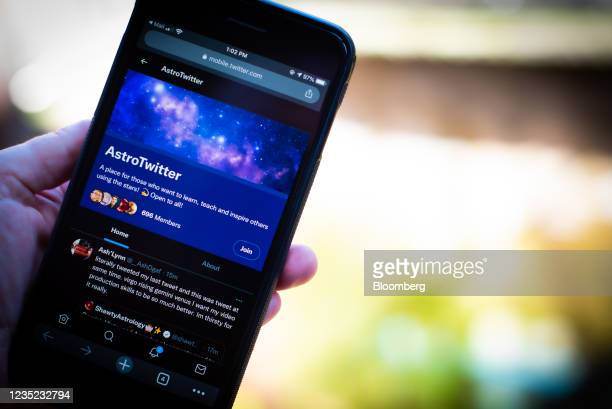The AstroTwitter Community group page on a smartphone arranged in the Brooklyn borough of New York, U.S., on Saturday, Sept. 11, 2021. Twitter Inc....