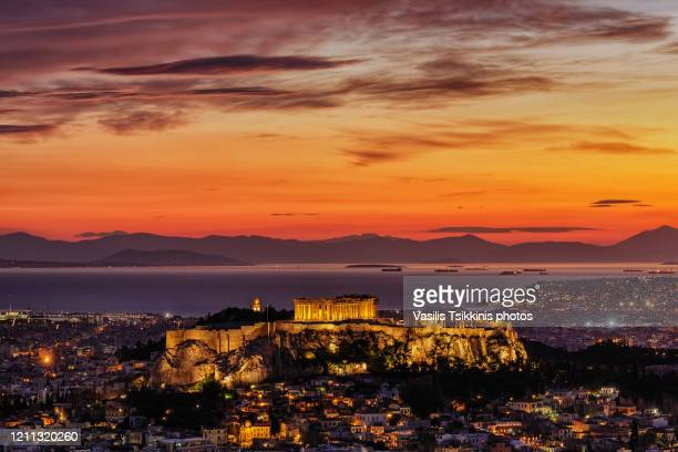 the athens acropolis after a winter sunset - greece stock pictures, royalty-free photos & images
