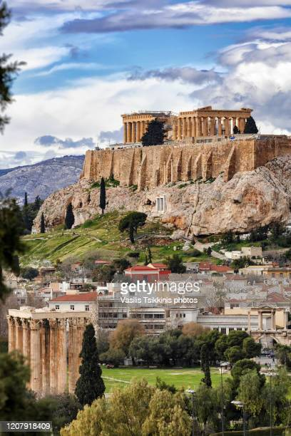 the athens acropolis and the temple of the olympian zeus - parthenon athens stock pictures, royalty-free photos & images