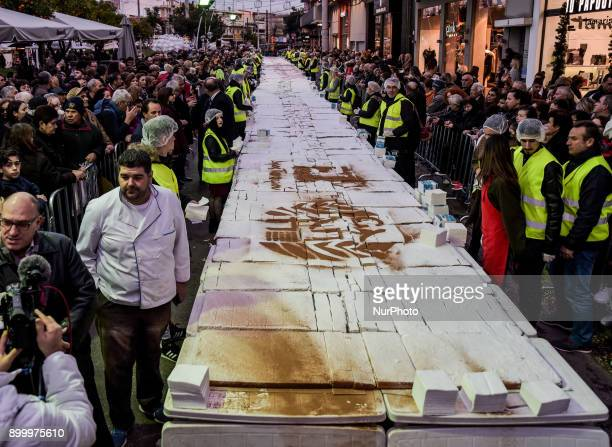 The Athens Bakers' Union and the Peristeri Municipality making a basil pie for the Guinness World RecordsThe huge New Year's Dessert that was cut and...