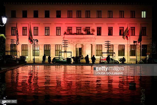 The Athens municipality buliding is seen illuminated in the colors of the German flag on December 21 two days after a truck crashed into a Christmas...