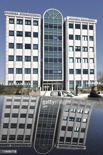 The Athens Stock Exchange is reflected in a car window on March 4 2010 Greece has frozen pensions and raised a string of taxes to cut spending by 48...