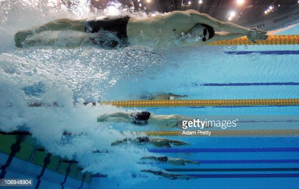 The Athletes dive in at the start of the Men's 200m Breaststroke final during day six of the 16th Asian Games Guangzhou 2010 at Aoti Aquatics Centre...