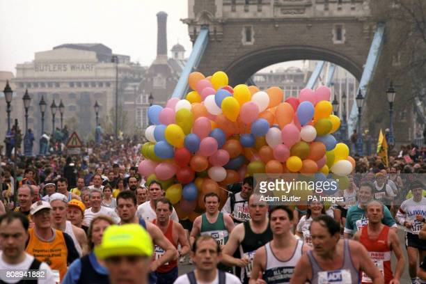 The Athletes including one tied to hundreds of balloons make their over Tower Bridge 36062 runner took part in the Marathon