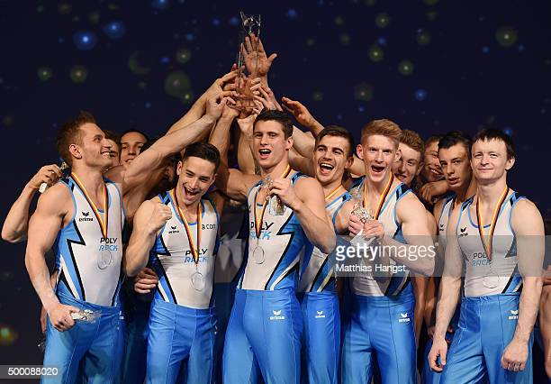 The athletes of KTV Straubenhardt celebrate during the medal ceremony after winning the Men's DTL Finals 2015 at Messehalle 2 on December 5 2015 in...