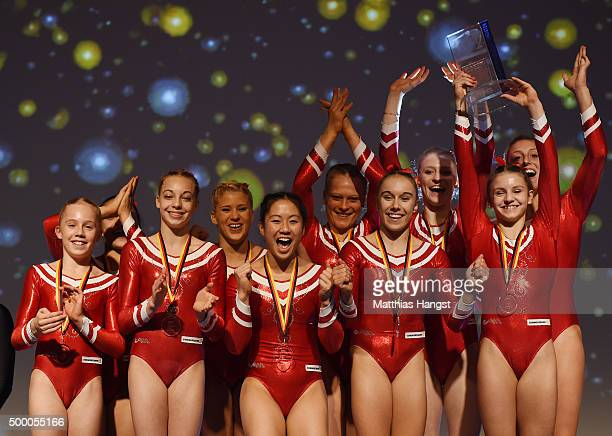 The athletes of MTV Stuttgart celebrate during the award ceremony after winning the Women's DTL Finals 2015 at Messehalle 2 on December 5 2015 in...