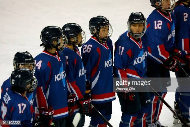 The athletes of Team Korea stand in line after the Women's Ice Hockey friendly match against Sweden at Seonhak International Ice Rink on February 4...