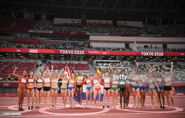 The athletes pose for a photo on the track after the Women's Heptathlon on day thirteen of the Tokyo 2020 Olympic Games at Olympic Stadium on August...