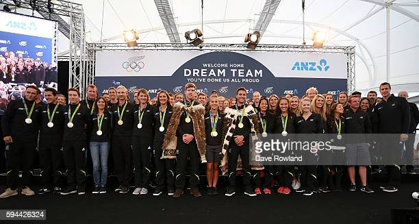 The Athletes pose for a photograph during the New Zealand Olympic Games athlete home coming at Auckland International Airport [OR] The Cloud on...