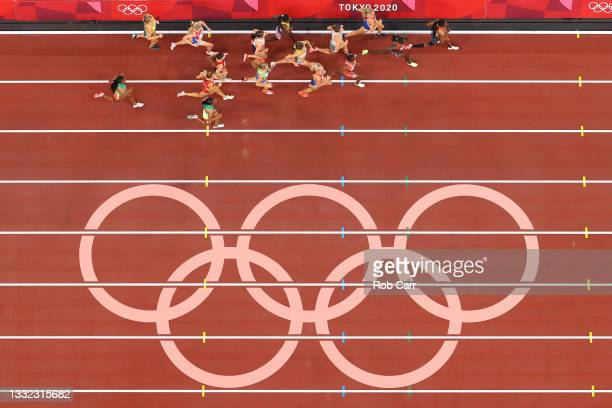 The athletes run past the on track olympic rings during the Women's 3000m Steeplechase Final on day twelve of the Tokyo 2020 Olympic Games at Olympic...