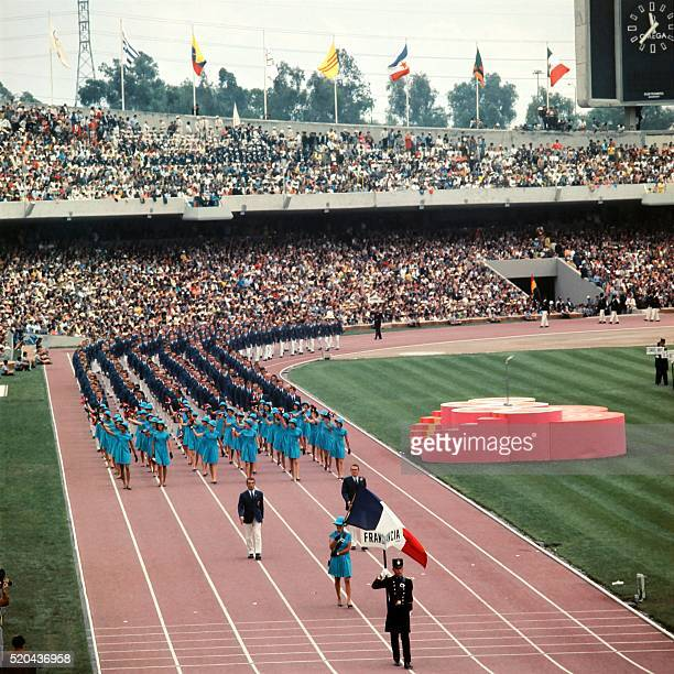 The athletic delegation from France parades during the opening ceremony of the 1968 Mexico Olympic Games on October 12 1968 5516 athletes...