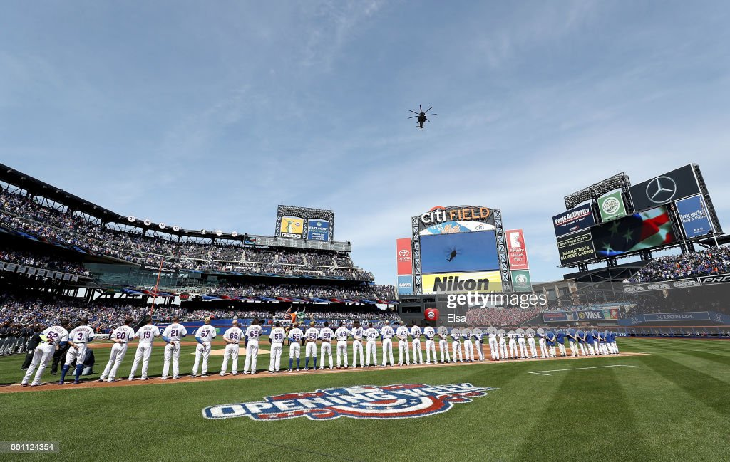 The Atlanta Braves and the New York Mets line up before Opening Day on April 3, 2017 at Citi Field in the Flushing neighborhood of the Queens borough of New York City.