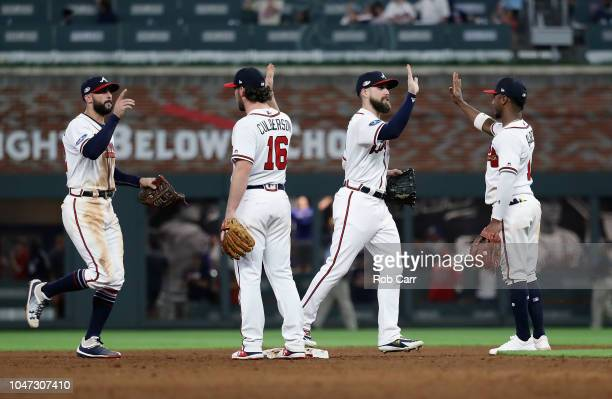 The Atlanta Braves celebrate defeating the Los Angeles Dodgers 65 in Game Three of the National League Division Series at SunTrust Park on October 7...
