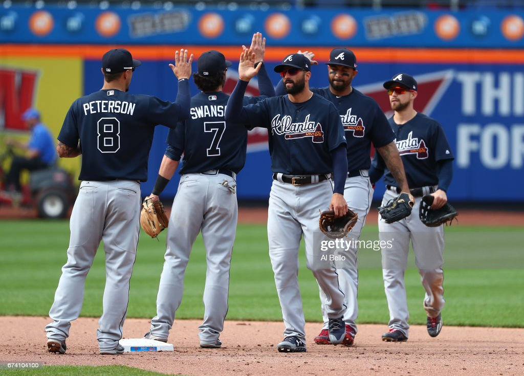 The Atlanta Braves celebrate their 7-5 win against the New York Mets at Citi Field on April 27, 2017 in New York City.