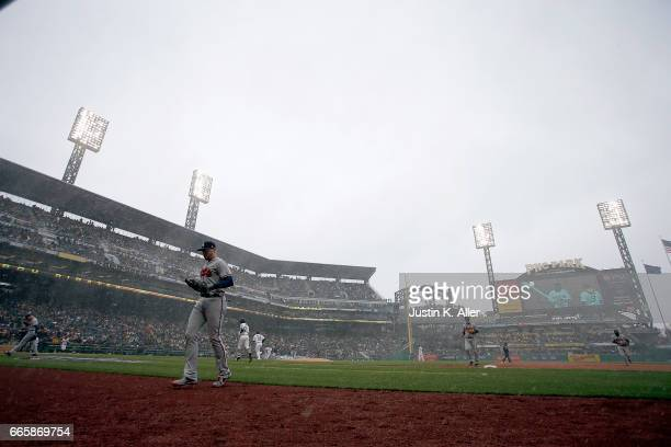 The Atlanta Braves come off the field in the fourth inning during a snow squall against the Pittsburgh Pirates on Opening Day at PNC Park on April 7...