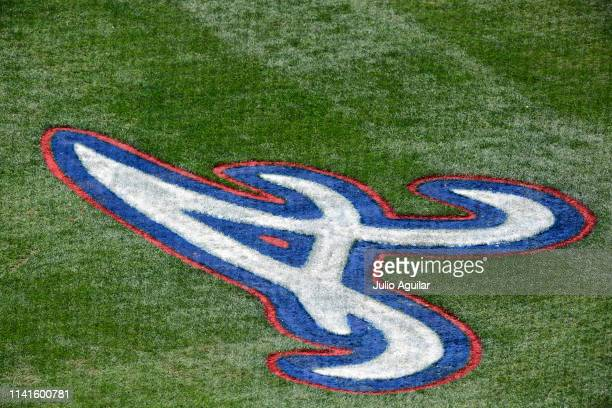 The Atlanta Braves logo is painted on the field at Champion stadium during a spring training game between the Atlanta Braves and the New York Mets on...