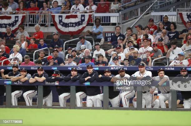 The Atlanta Braves looks on from the dugout in the eighth inning of Game Four of the National League Division Series against the Los Angeles Dodgers...