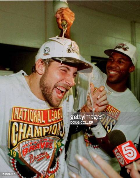 The Atlanta Braves pitcher John Smoltz gets sprayed with champange by teammate Jermaine Dye after winning the National League Championship series 17...