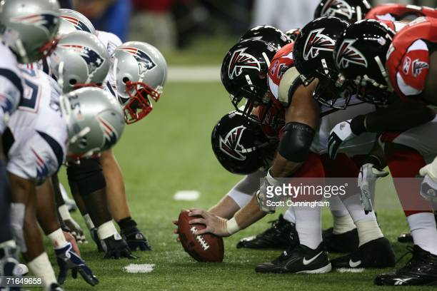 The Atlanta Falcons and the New England Patriots line up before the snap at the Georgia Dome on August 11, 2006 in Atlanta, Georgia. The Falcons...