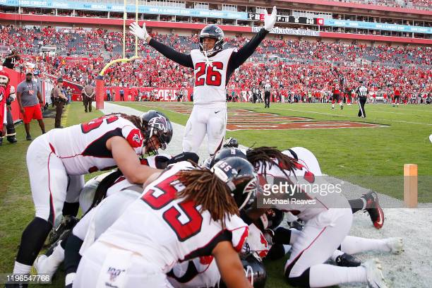The Atlanta Falcons celebrate after Deion Jones intercepted a pass by Jameis Winston for a touchdown to defeat the Tampa Bay Buccaneers 2822 in...