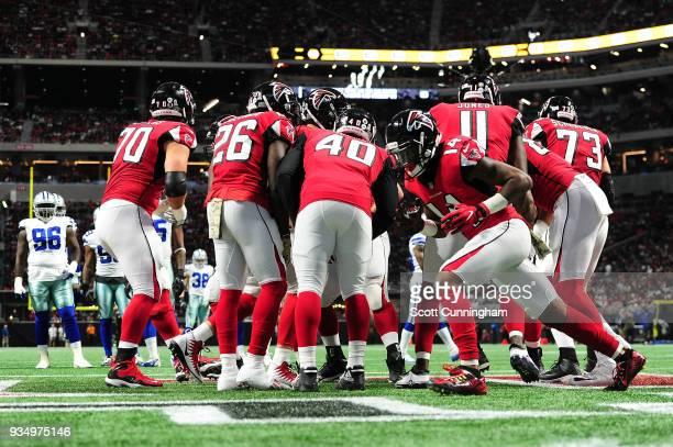 The Atlanta Falcons huddle against the Dallas Cowboys at MercedesBenz Stadium on November 12 2017 in Atlanta Georgia